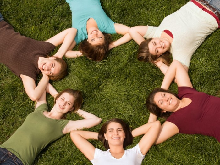 Friends-lying-in-a-circle-on-the-grass-e1421276127235