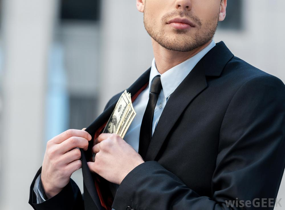 company-executive-putting-money-in-jacket