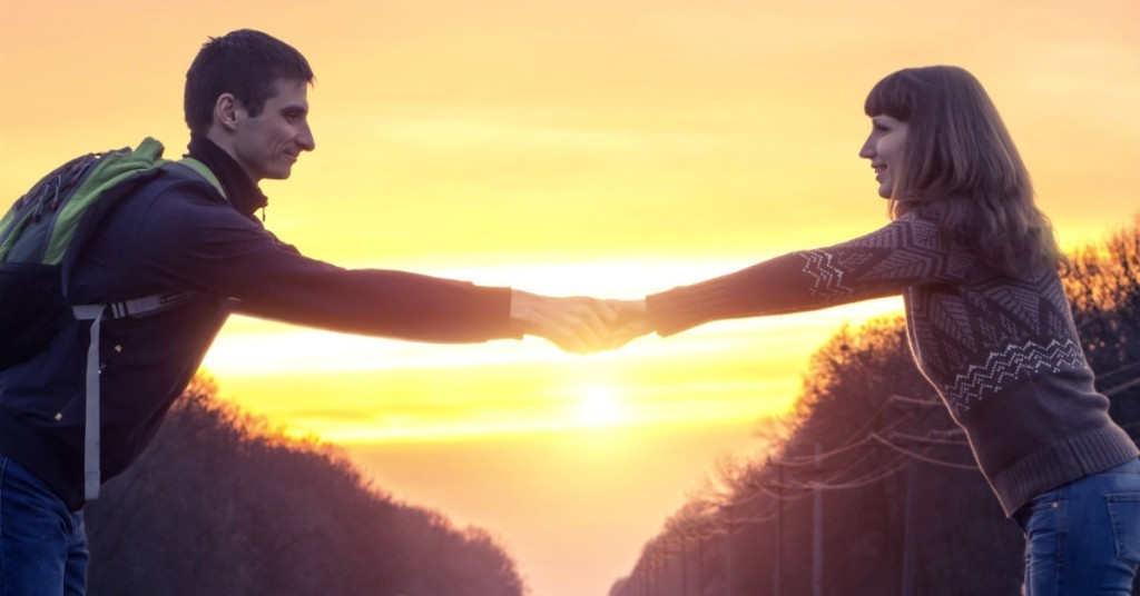 24674-couple-long-distance-reach-apart-arms-hands-light-sunset-rise-wide.1200w.tn